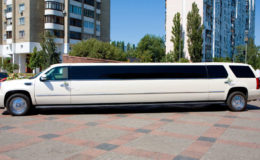 White Wedding Limousine. Ornated with flowers.